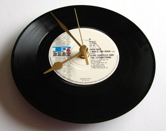 """ELVIS COSTELLO Vinyl Record Wall CLOCK. """"Everyday I Write The Book"""" Made from a recycled 7"""" vinyl record Punk rock new wave 80s black white"""