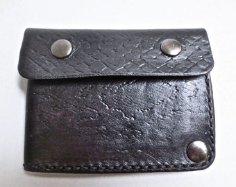 Black leather wallet embossed with snakeskin design, leather billfold