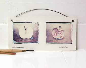 Apple, Pomegranate.  Polaroid Transfers Printed on Hand Made Fired Clay.  Photographs Printed On Ceramic.