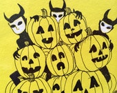 Original goblins in pumpkin patch drawing in black and white India ink on bright yellow archival paper.