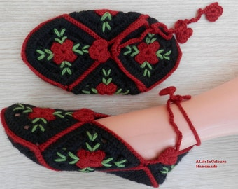 Handmade crocheted women's slippers with red roses.
