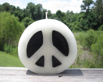 Sandalwood scented peace sign candle