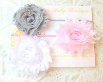 60% off entire purchase...Set of 3 Flowers on thin elastic