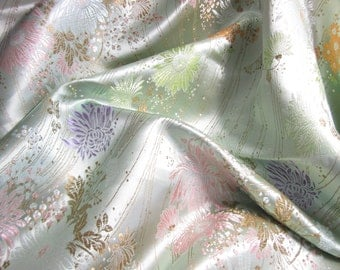 Chinese brocade fabric in pale green - ONE yard of light green satin brocade fabric with a floral design in lilac, pink, gold and bronze