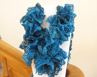 Blow out Sale! Crocheted Teal ruffle scarf with sequence accents throughout.