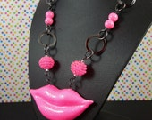 Neon pink glitter polymer clay lips necklace