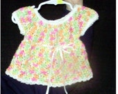 Multicolor crocheted dress for a precious little girl.