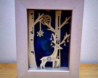 3D handmade paper sculpture Stag in the forest.