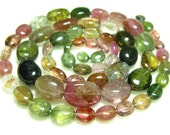 "Tourmaline Smooth Oval Nuggets- 14"" Strand -Stones measure- 4-8mm"