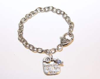 Dreaming of the Sea with Shell Stamped Silver Charm Bracelet