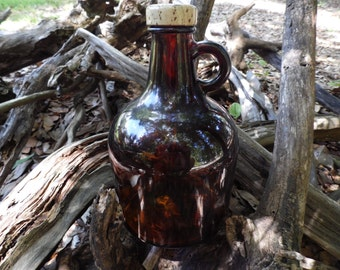 Vintage brown jug. It has the number 55 then a design and a large 10 on th bottom. Bottle to says shake well.