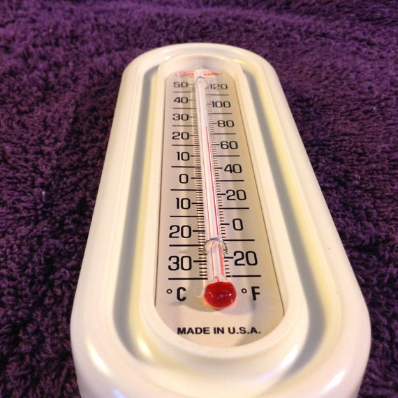vintage thermometer with sunbeam bread bakery by
