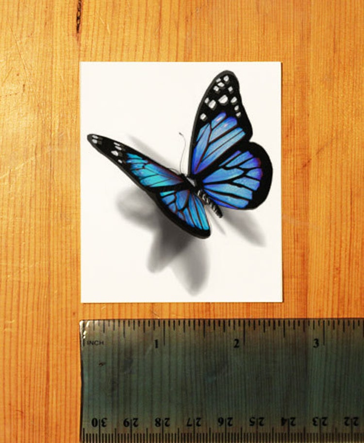 3D Blue Butterfly Temporary Tattoo Looks Like If By TattooMint