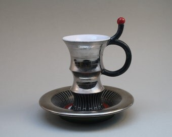Platinum cup & saucer by Thomas Kummer