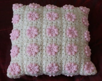Pink and cream crochet flower cushion
