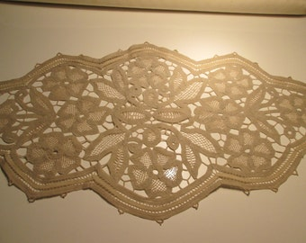 Old and beautiful doily lace and lace hand. Beige