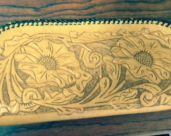 Vintage hand tooled leather clutch
