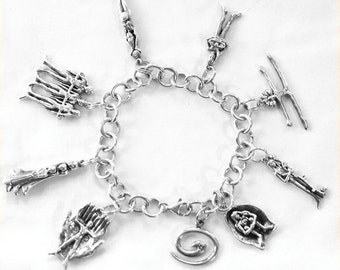 Chikara Charm Bracelet, sterling silver with 9 intentional charms