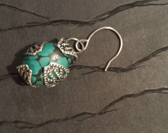 Antique metal wrapped turquoise earrings