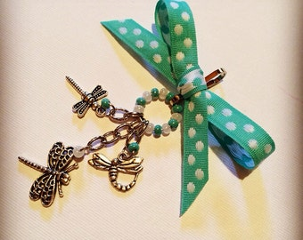 Dragonfly themed purse charms.