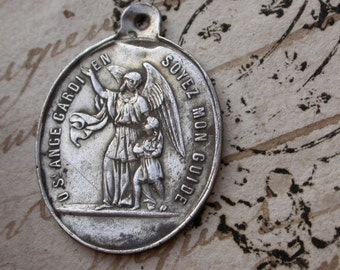 French antique 19th century sterling silver St josephe sterling ornate St ange gardien angel  child gothic medals