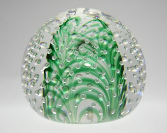 Vintage green glass paperweight with controlled bubbles