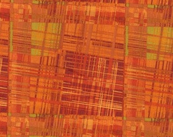 A great plaid consisting of multiple colors of rust, orange, burnt orange and a complimentary touch of green