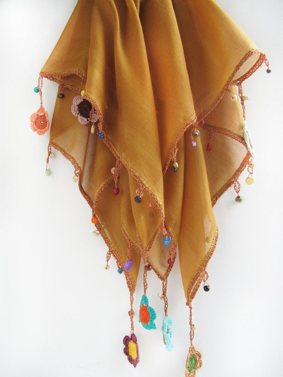 mustard color scarf made by bead and lace handiwork on edge
