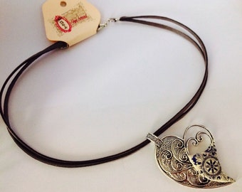 Heart pendant with an old silvery finish.