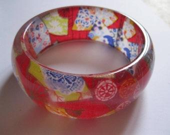Bangle - Chunky funky multi colour floral plastic bangle retro design