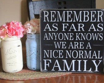Remember as far as anyone knows we are a nice normal family funny wood sign