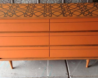 Sold orange mid century modern dresser with intricate Mid century furniture denver