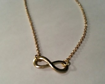 Golden coloured infinity necklace