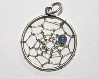Spider's web circular pendant with bead