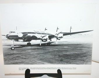 Vintage Black & White airplane photograph of a Lockheed Super H Constellation Flying Tiger Line