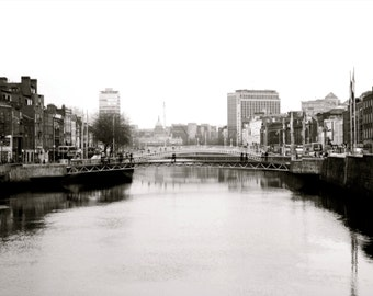 "Irish street photography ""Across The River"", Ha'Penny Bridge, Halfpenny Bridge, Dublin, Ireland, River Liffey, water, photos of Dublin"