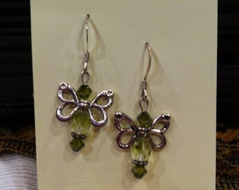 Olive green and silver pierced butterfly earrings.