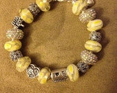 For Danielle only! Yellow murano beads with white rhinestones.