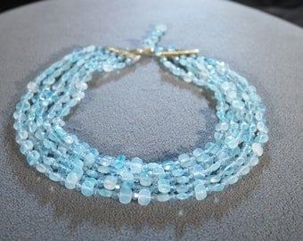 Vintage 17 Inch 5 Strand Necklace Featuring Opalescent Blue Glass Beads  B