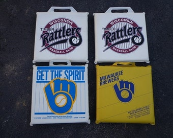 2 Brewers baseball seat cushions from the old county stadium and 2 Timber Rattlers cushions.excellent shape