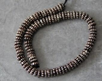 "Buffalo Bone Carved Roundel Beads, 18"" long full strand"