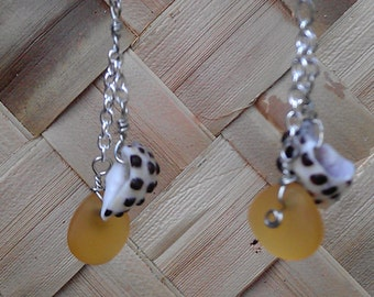 Earrings of yellow seaglass and drupe shell from Maui on leverback ear wires.
