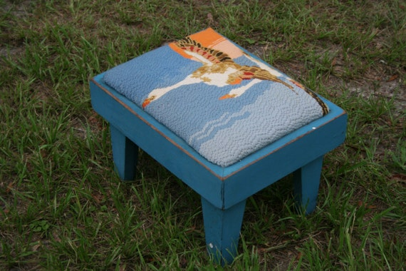 Cute vintage blue foot stool has duck or geese on it in a