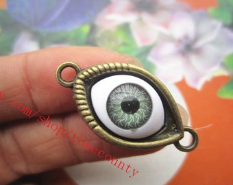 wholesale 100pcs antiqued bronze Evil eye 30x15mm charms findings connectors