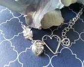 Open Heart Sterling Silver Bracelet with sterling silver heart chain & sterling silver puffed heart.