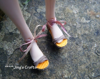 MOMOKO a pair of brown leather sandals  by Jing's Crafts