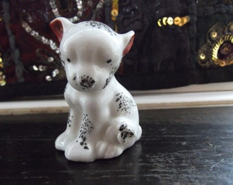 vintage porcelain spotted dog with fly