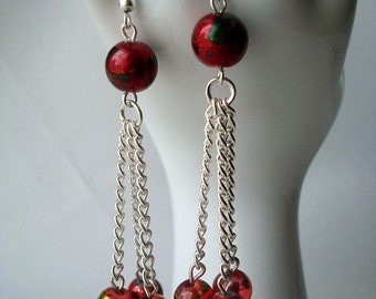 Dangling long earrings with balls