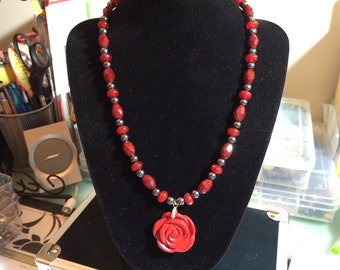 Glass and hematite necklace with rose pendant