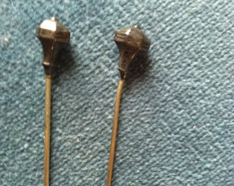 Two matching antique hatpins